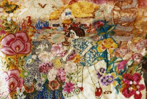 Tapestry of a girl on a background of flowers